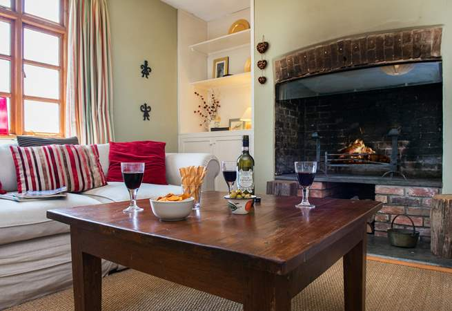 Another wood-burner in the sitting-room makes this an ideal retreat all year round.