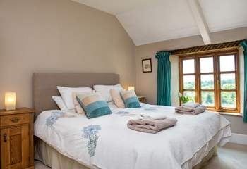Bedroom 1 is beautifully furnished and enjoys views over the garden.