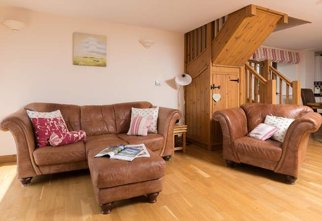 There are two wonderful squishy sofas and a deep armchair too. Plenty of choice for you all.