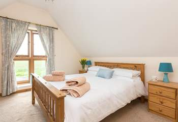 This is the double bedroom with its king-size bed and views across the countryside.