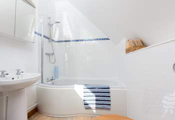 The bathroom offers a lovely bath or a shower if you prefer. There is a heated towel rail for toasty towels.