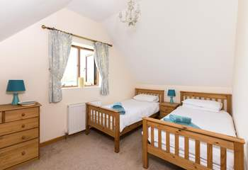 This is the twin bedroom. This room is very spacious and looks far across the farmland with a glimpse of the Quantock Hills in the distance.