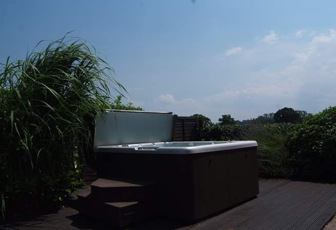What a setting for the supersize hot tub, in a private garden with countryside views across the fields.