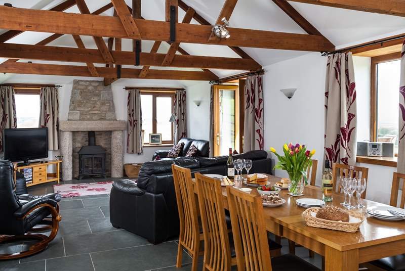 The lovely open plan living place has a wood burner for those chillier evenings.