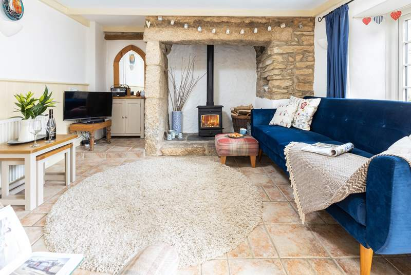 The cosy living room with a crackling fire for those cooler evenings.