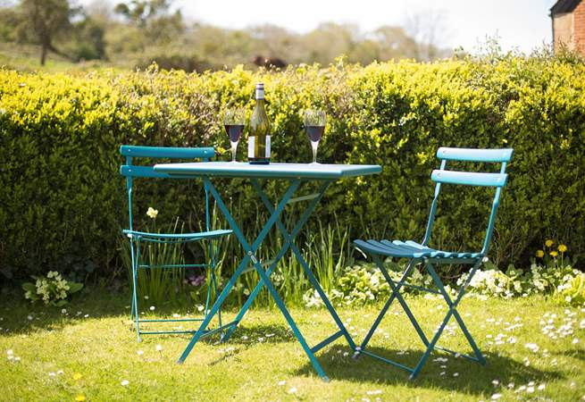 The lawned top part of the garden is a good place to sit and enjoy a drink.