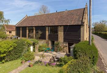 An overall view of Hayloft in its setting within the small group of barn conversions - just three others.