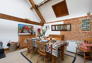 There is a lovely farmhouse dining-table - plenty of seating if your party books Flax Barn too.