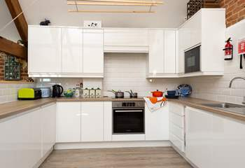 The new kitchen balances perfectly with the traditional style of this lovely welcoming property.