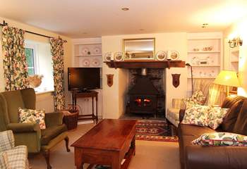 The elegant sitting-room has a wood-burner at each end.
