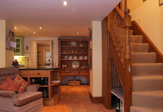 Stairs lead from the open plan living-area to the bedrooms and bathroom on the first floor.