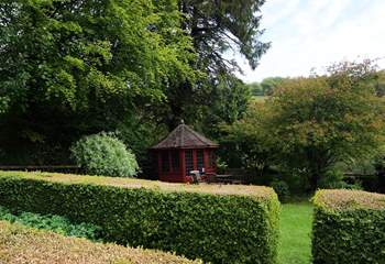 There is a pretty raised garden with a summer-house and seating-area.