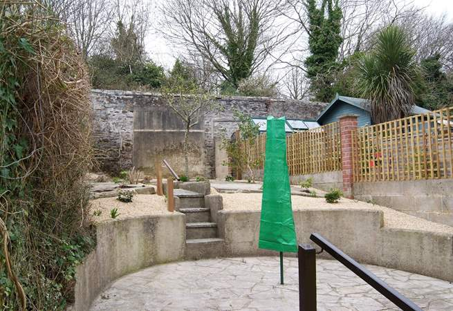 The gravelled, terraced rear garden (take care on the steps) has a patio-area.