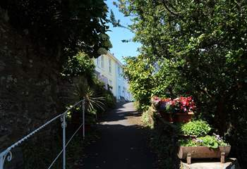 The path up from the road to the row of cottages.