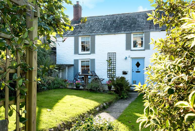 The garden path leads you to the delightful Court Cottage.
