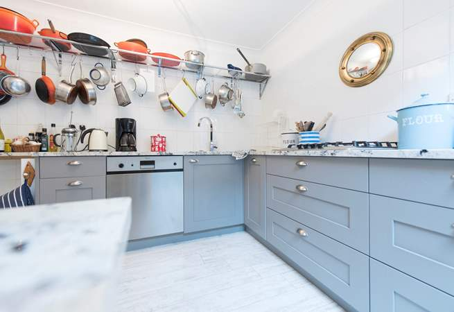 The kitchen is characterful and well-equipped.