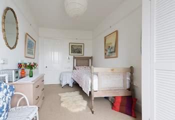 The pretty single bedroom has sea views.