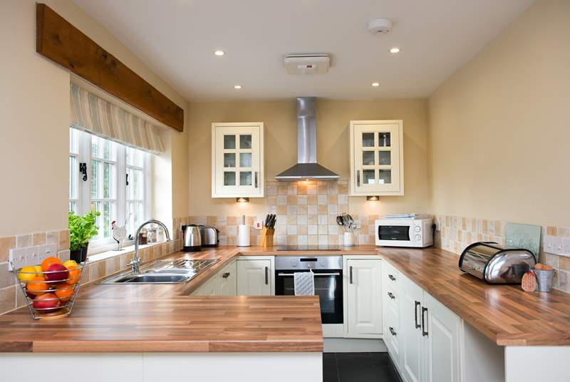 The kitchen is light and airy and well-equipped.