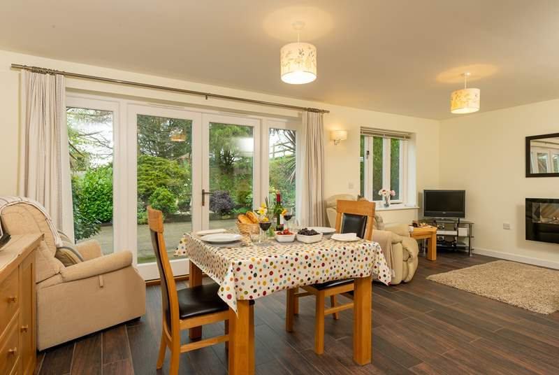 The bright and spacious open plan living space has French windows out onto your patio.