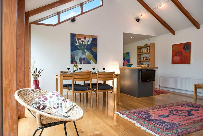 The spacious living area- which has wonderful views of the countryside setting