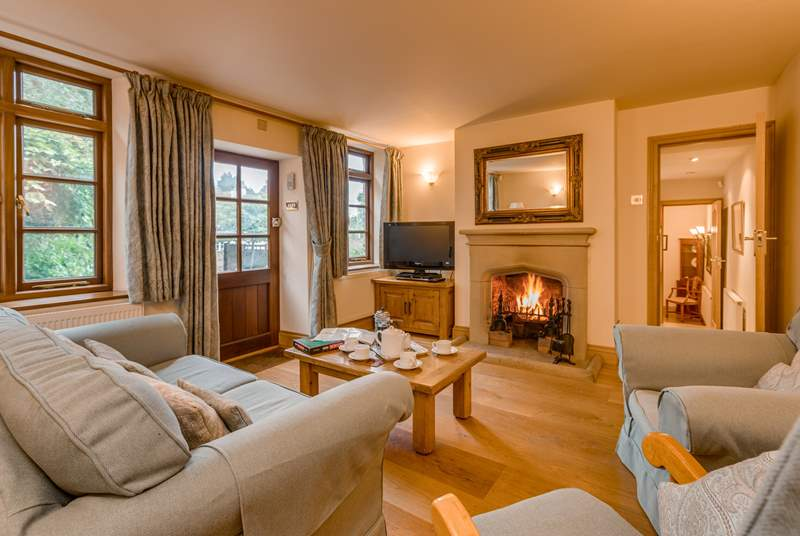 The cottage has a wonderful traditional feel with a large stone fireplace, an open fire and solid oak floors throughout.