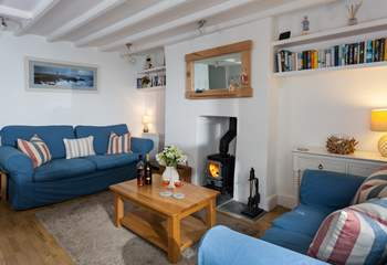 The sitting-room has a roaring wood-burner. Perfect for those chillier evenings.