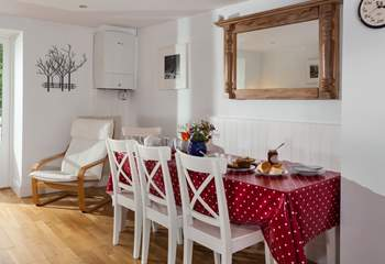 Get all the family together around this large dining table (there is a bench to perch on, which is tucked under the table opposite the chairs)