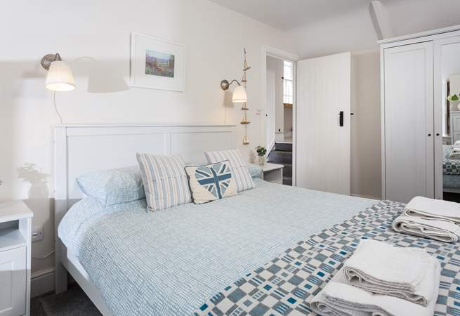 Pretty bedroom two. As you come out of the door you will find four steps which lead up to the family bathroom.