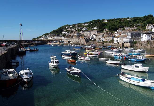 Step outside of Pender Cottage and onto the harbour edge in Mousehole.
