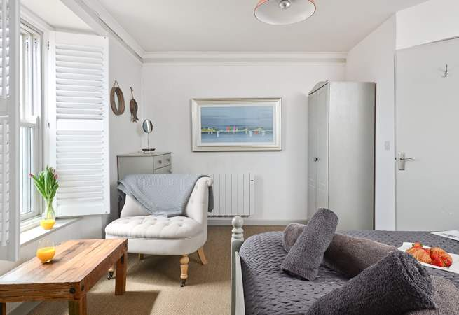 The master bedroom has a sitting-area from which to enjoy watching the ebb and flow of the tide.
