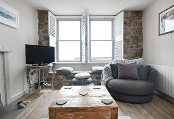 The sitting-room overlooks the harbour.