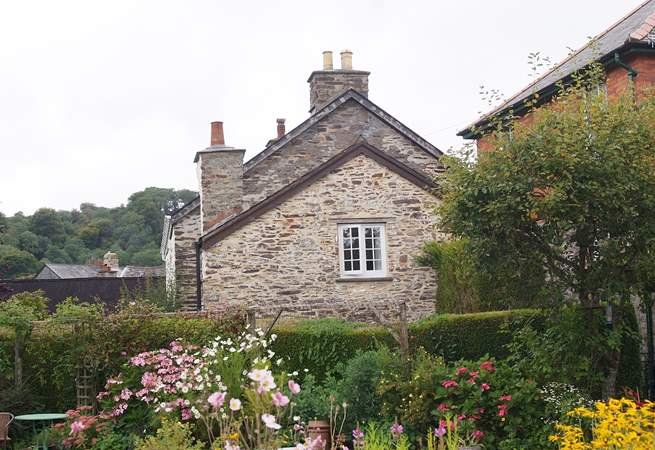 A view of this pretty end of terrace cottage, taken from the neighbouring gardens.