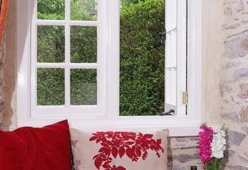There is a pretty window seat in the sitting-room.