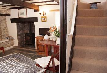 Steep cottage stairs lead to the bedroom and bathroom - please take care of the low lintel.