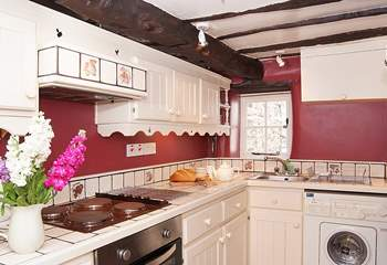 The galley-style kitchen has access to the private patio at the rear of the cottage.