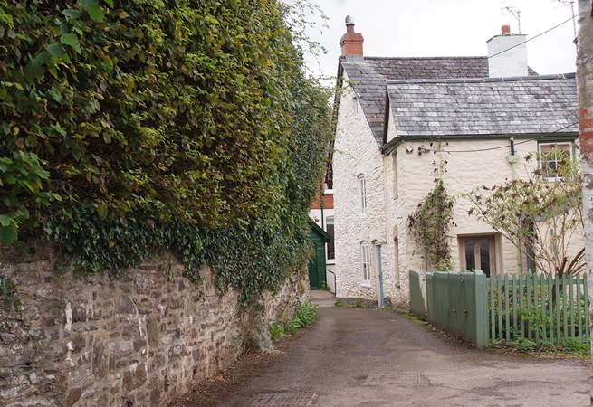 This is the entrance to Rosemary Lane. Lane Cottage is off a tiny square with private parking at the end of the lane.