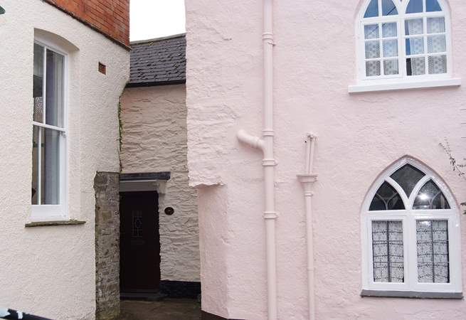 The black is the front of Lane Cottage - the key safe and back door are around to the left, down the passage.