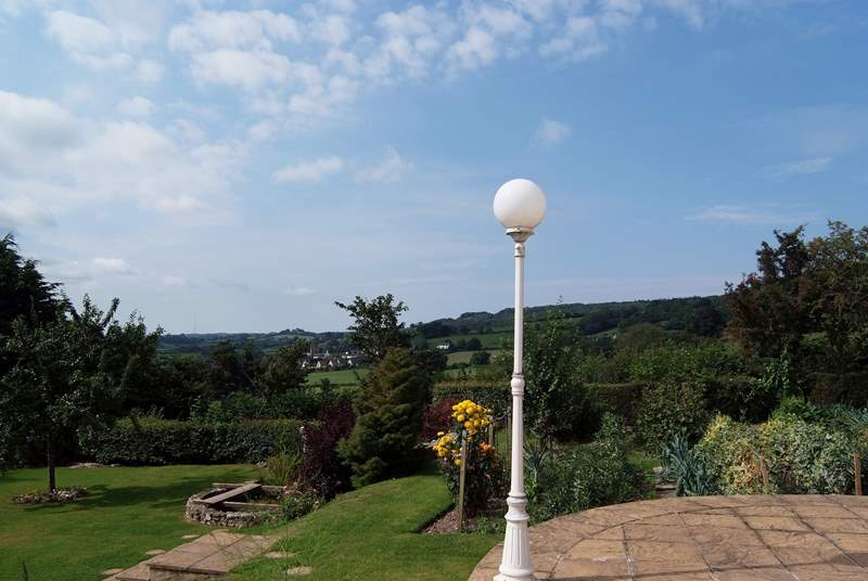 This is the view from the patio, looking across the garden that you are invited to enjoy, towards Yarcombe in the distance.