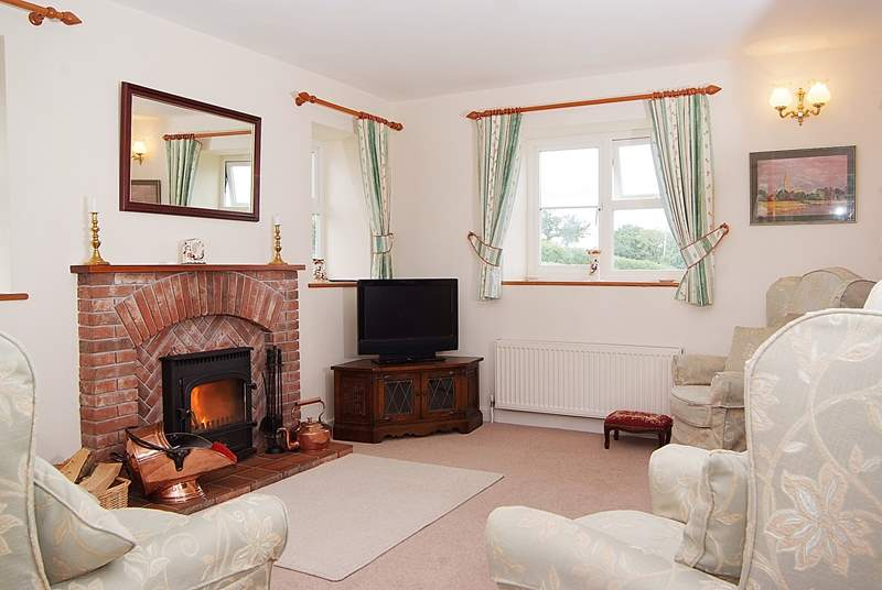 The sitting-area is a cosy and comfortable place to return to after a day out exploring. The reverse level accommodation really makes the most of the views.