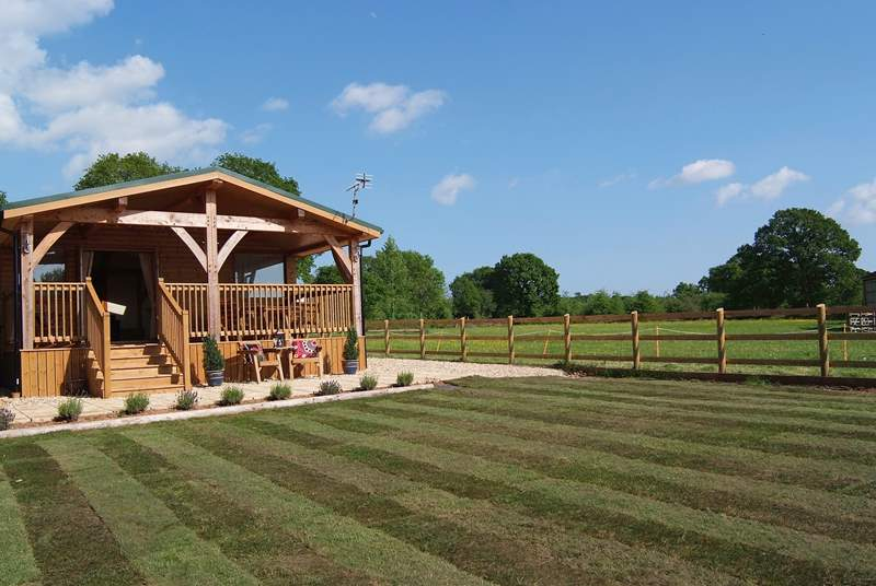 This bespoke wooden framed Lodge has a really luxurious interior and is in a private setting with a lovely feeling of open space around it.