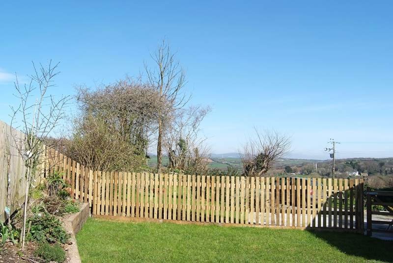 There are far reaching views over the Ladock valley from the enclosed garden.
