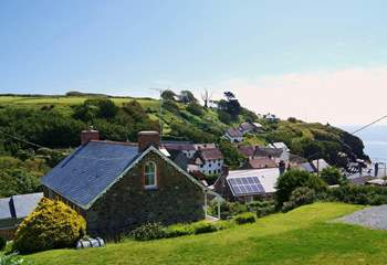 Set on the hillside overlooking the cove, Coth Lytherva has a large garden which includes plenty of parking space at the side.