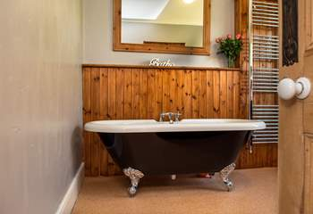 There is a family bathroom on the ground floor, enjoy a soak in the tub.