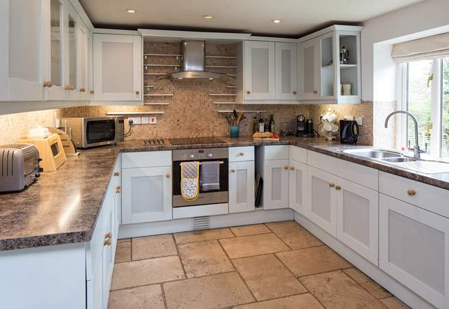 Light pours into this lovely well-equipped kitchen.