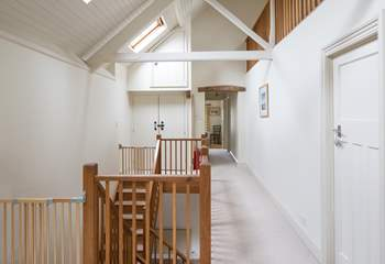 The hall from the top of the stairs into the sitting-room leads to the four bedrooms and family bathroom.