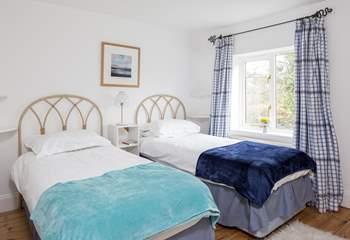 Delightful twin bedroom.