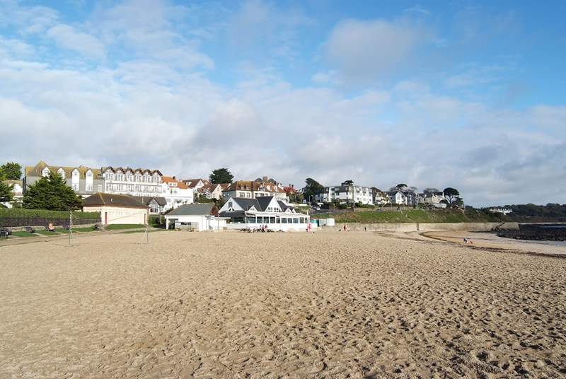 Looking from the end of Gyllyngvase beach towards the popular beach cafe with Falmouth seafront behind.