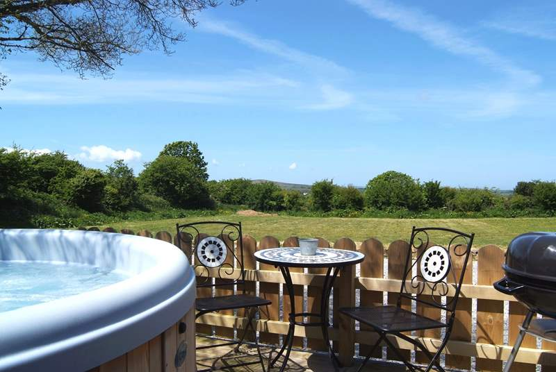Meadow's private hot tub enclosure, with lovely views across the meadow and beyond.