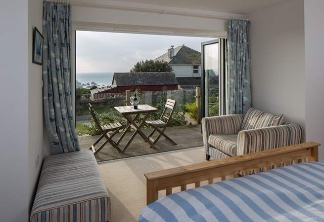The ground floor double bedroom (Bedroom 1) has patio doors out to a small deck and some gorgeous views.