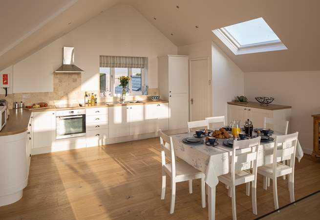 Light pours in to this well-equipped kitchen.